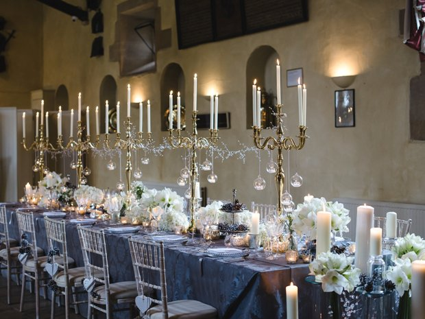 Candelabras, white flowers and metallics create a striking look. © Weddings by Nicola & Glen.
