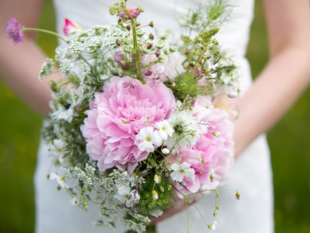 Whimsical natural bouquets are a beautiful addition to summer wedding celebrations.