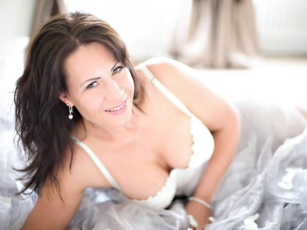 A boudoir photo will give your confidence a great boost before the wedding day.