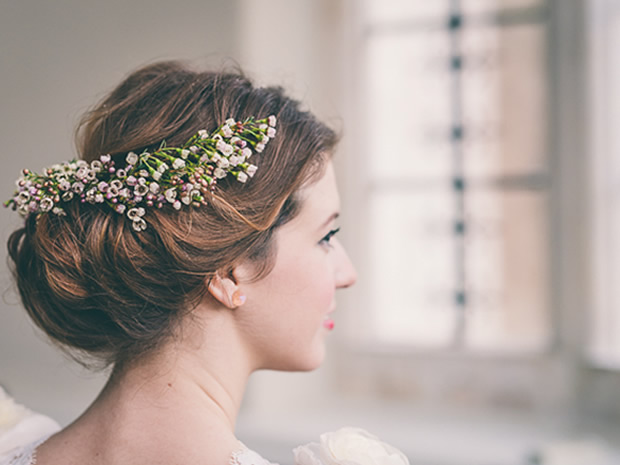 Floral hair details are a popular look for brides. The Flowers Girls, image © Rob Tarren.