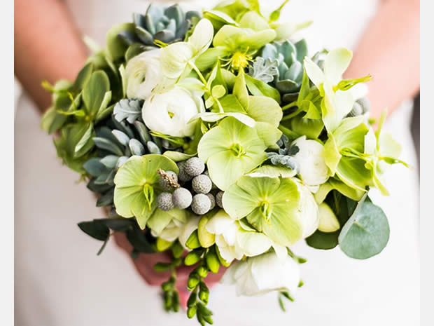 This fresh bouquet by Flower Style Co includes green hellebores, white ranunculus, cineria, eucalyptus, mini succulents and white freesias.