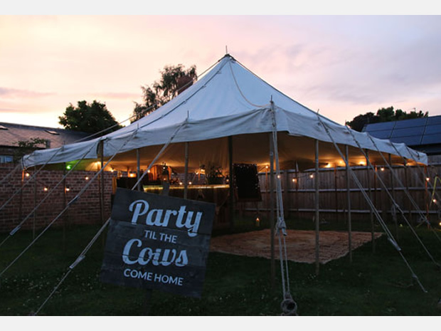 Add a pole marquee with sound system and lighting.