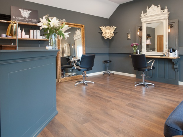 The salon has been furnished with antiques and reclaimed materials.