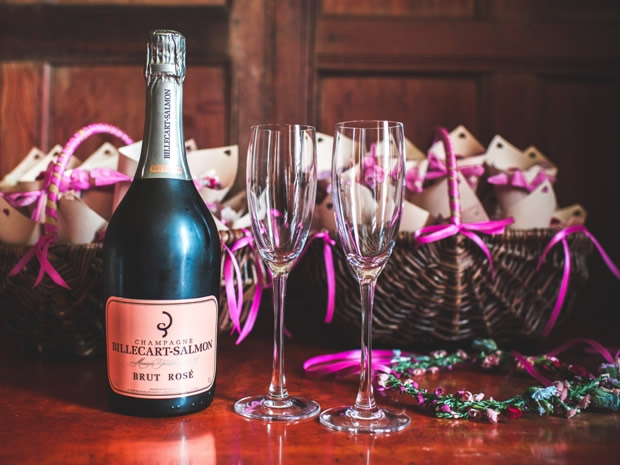 Time to toast the happy couple with confetti and a glass or two of pink champagne.