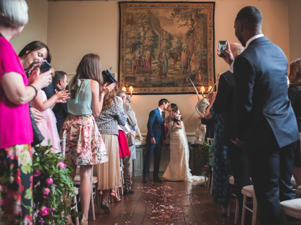 Family and friends look on as Nadia and Colin tie the knot in The Hall at Elmore Court.
