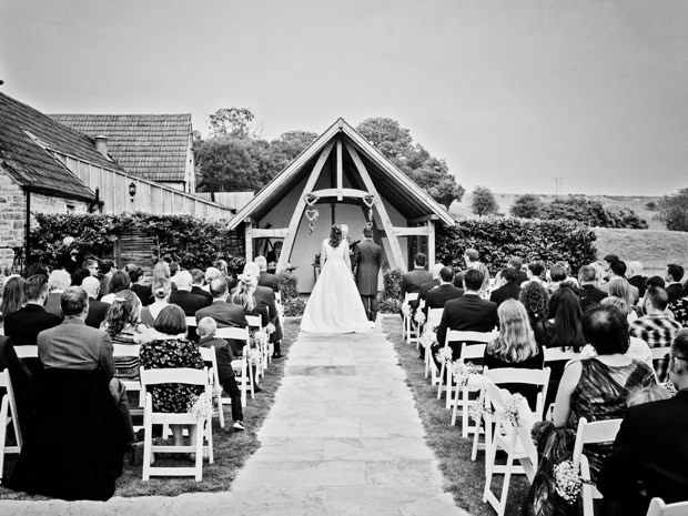 Helen and Stephen prepare to say 'I do' in the breathtaking outdoor setting.