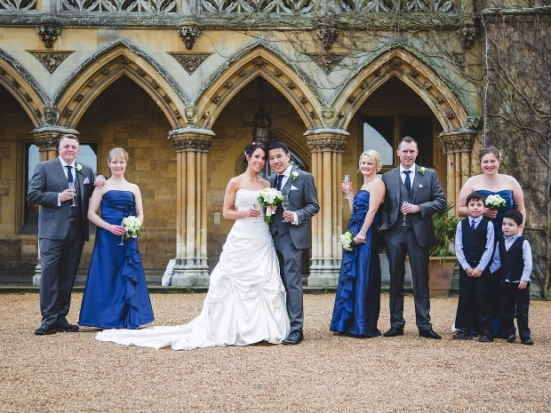 The bridesmaids wore striking floor-length midnight blue dresses.