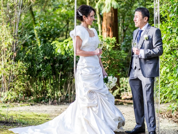 The couple raise a glass in the beautiful outside space at Manor By The Lake.