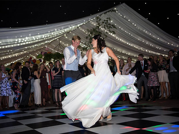 Brides and grooms can add a dance floor to their wedding marquee!