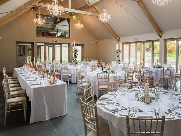 The Orchard Barn is a lovely space for wedding breakfasts. Image © Paul Willetts Photography.