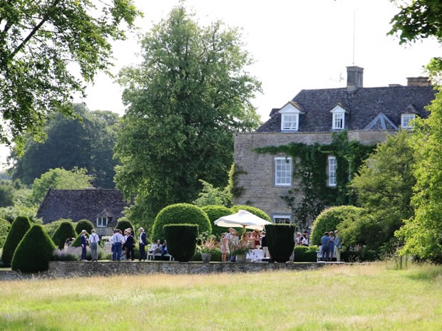 The gardens of Cornwell Manor make a lovely setting for post-ceremony drinks.