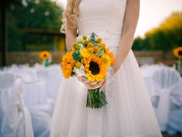 A striking yellow bouquet is the perfect choice for summer wedding celebrations.