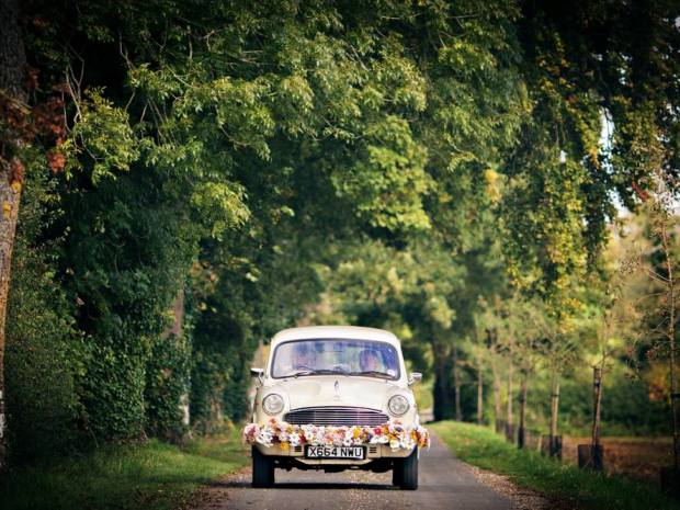 Kushi Cars offer a stylish and unique way to get brides to their wedding venue on time.